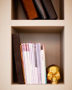 gold skull book end